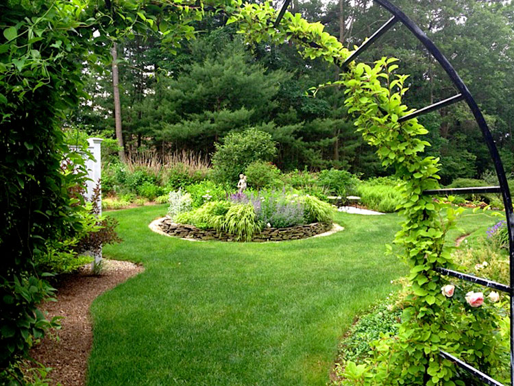 Arbor leading to beautiful perennial gardens