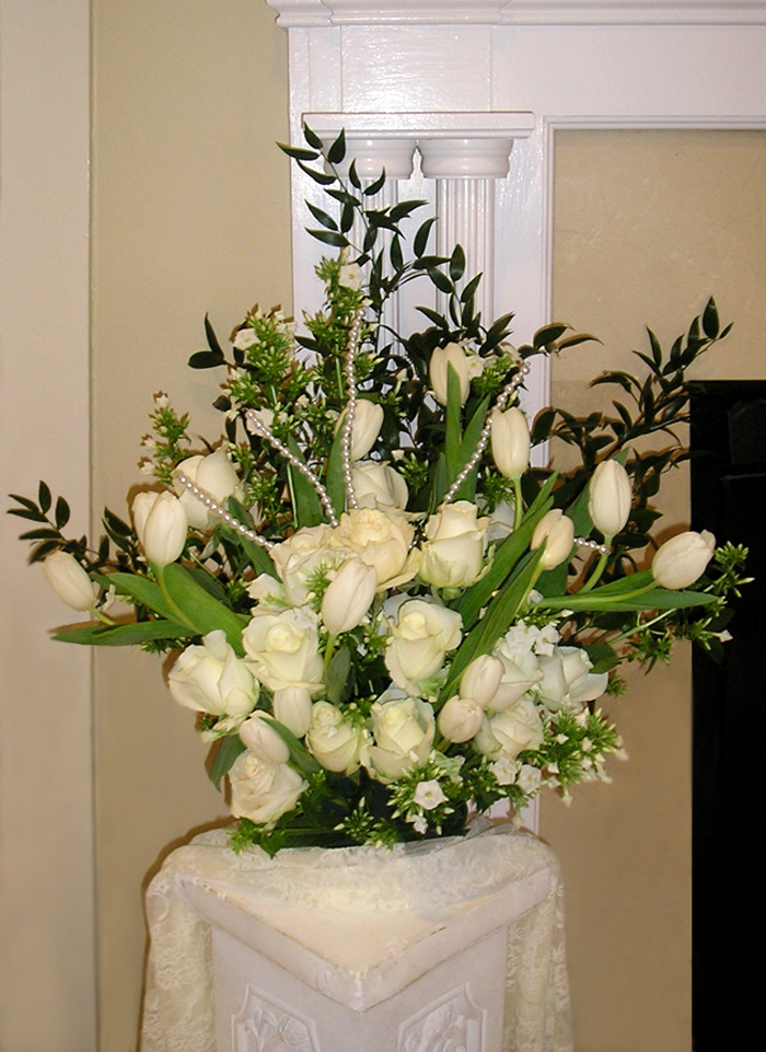 Cream & white wedding reception centerpiece