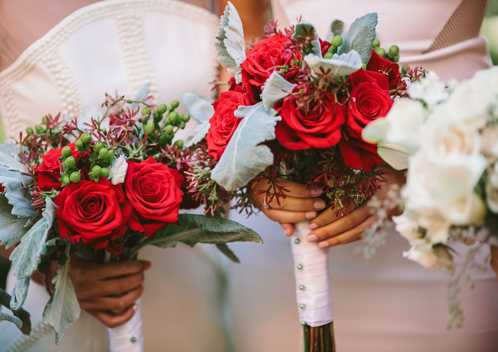 Bridesmaids bouquets with red roses, dusty miller & hypericum berries : Photo by Shane Godfrey