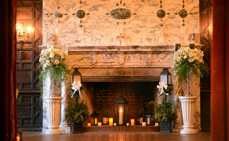 Romantic candle-lit wedding ceremony floral arrangements