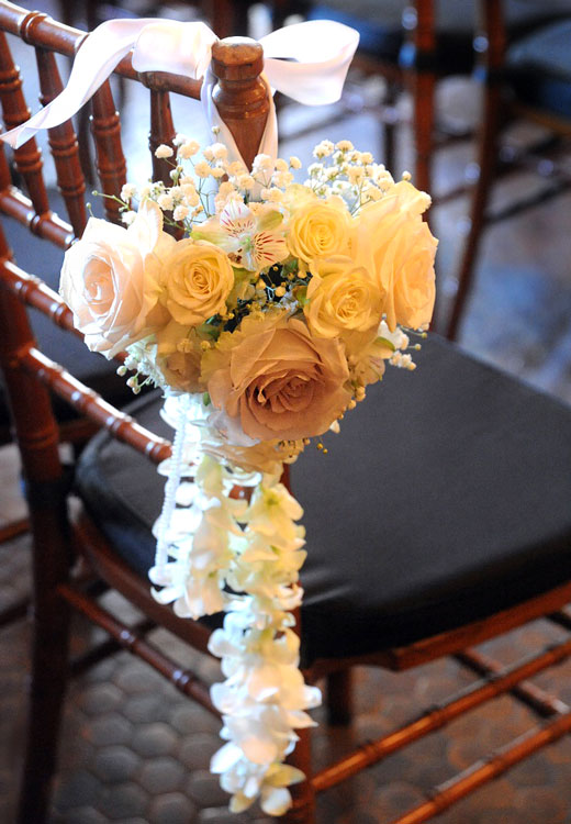 Wedding ceremony chair swag with roses & orchids