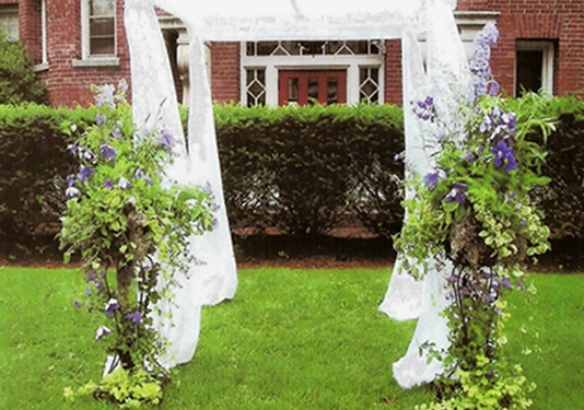 Chuppah with florals, clematis & cut garden flowers