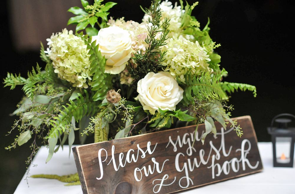 Floral arrangement with herbs, ferns & greenery