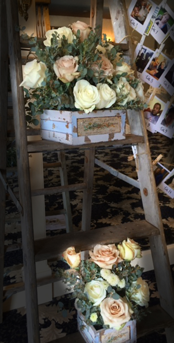 Rustic ladder with flowers essex room