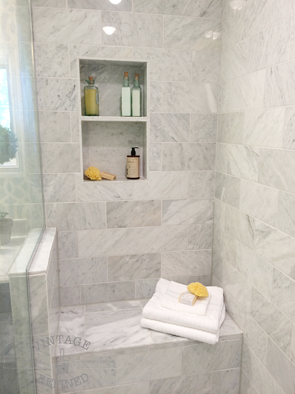 marble shower niche and bench