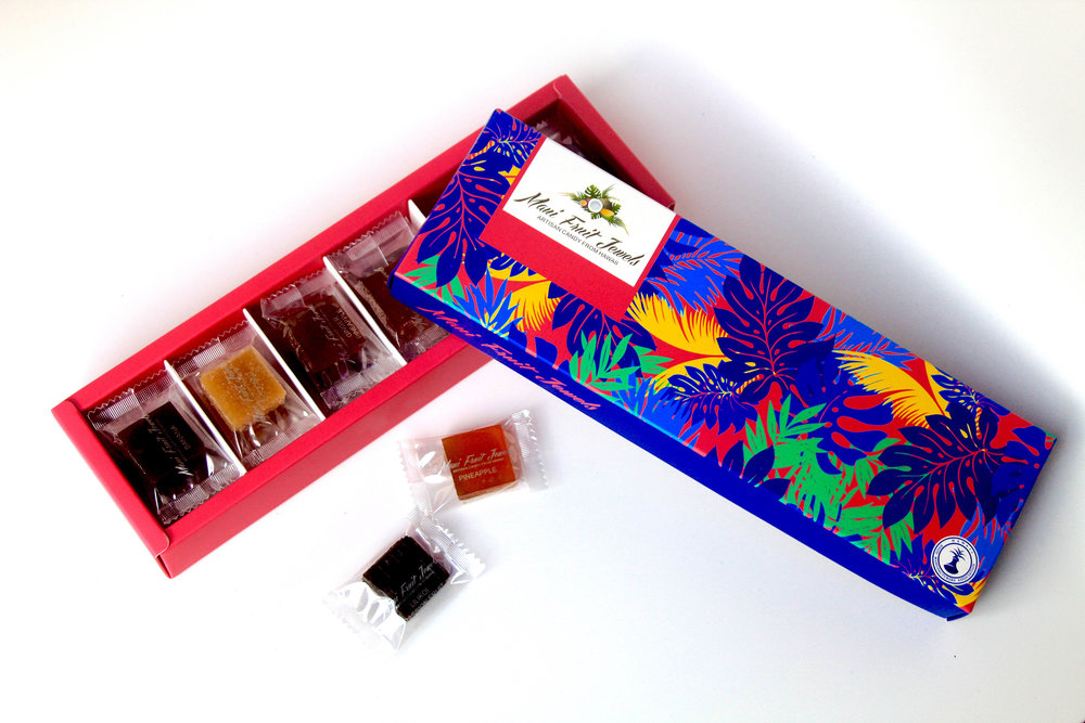 Maui Fruit Jewel's Lahaina Collection is a gift-quality presentation box filled with a comprehensive assortment of fruit, spice, wine, and herb-flavored candies, including 18 flavors. Visit www.MadeInMauiCounty.com for more locally made products.