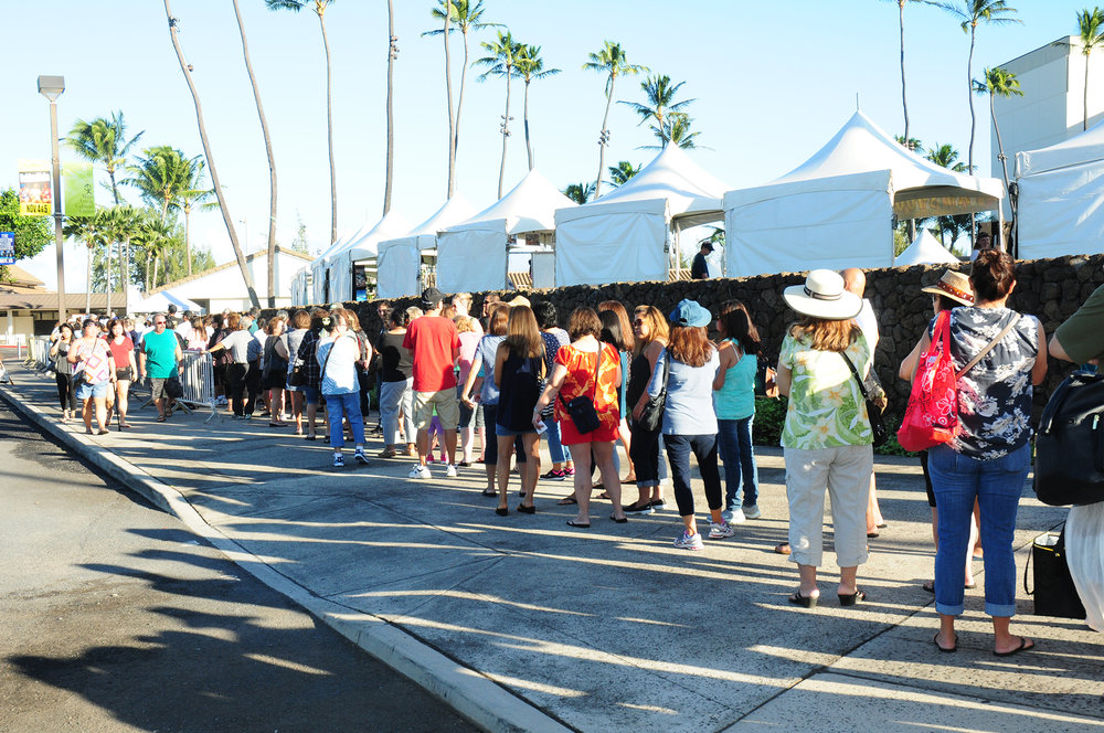 Before gates opened on Saturday, a long lined formed around the Maui Arts & Cultural Center. The first 2,000 people received a free Festival tote.
