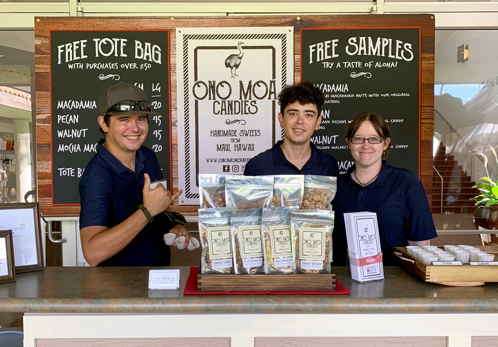 First-time festival vendor, Ono Moa Candies, featured their Maui handmade candied macadamia nuts, pecans, and walnuts. Pictured (from left): Sean O'Hanlon, Nathan O'Hanlon, and Marie Stacey (owner).