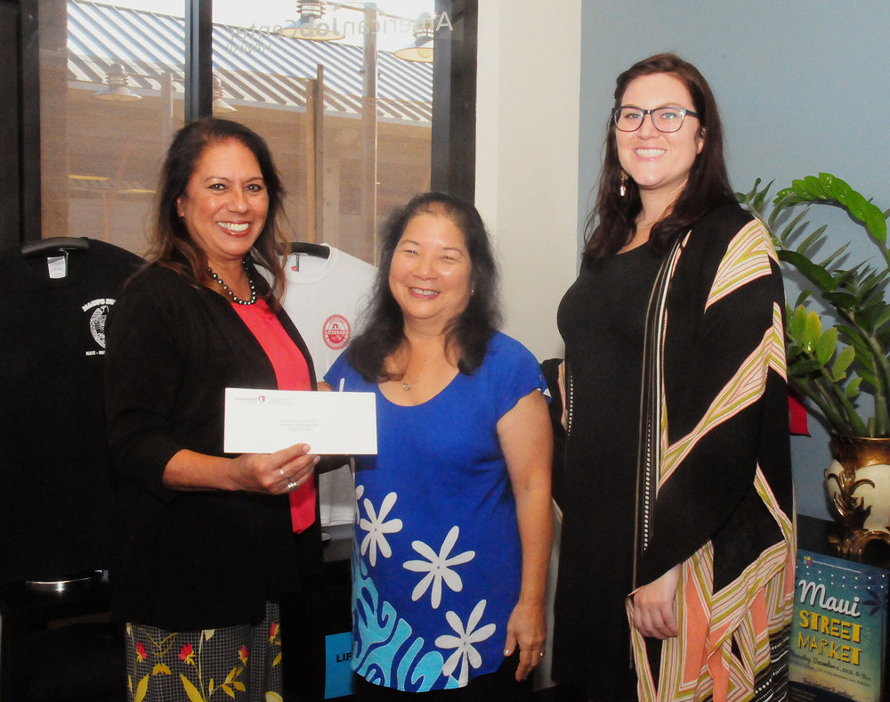 Hawaiian Airlines' Leona Duarte (far left) and Maui Chamber of Commerce's Amber Coutsos (far right) with Gayle Hart (middle).