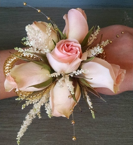 Peach spray roses and astilbe with gold accents.