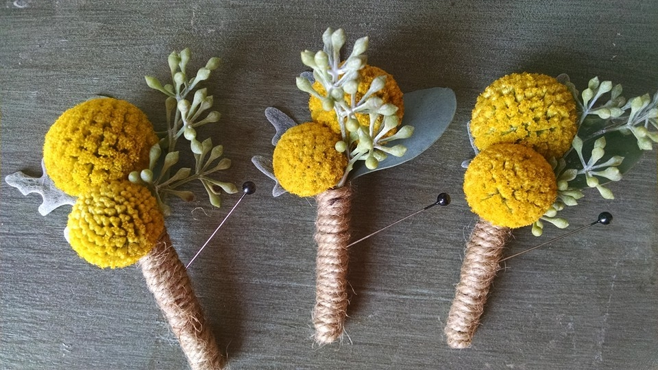 Billy balls, dusty miller and eucalyptus seeds make these look sharp with the twine wrapped stems.