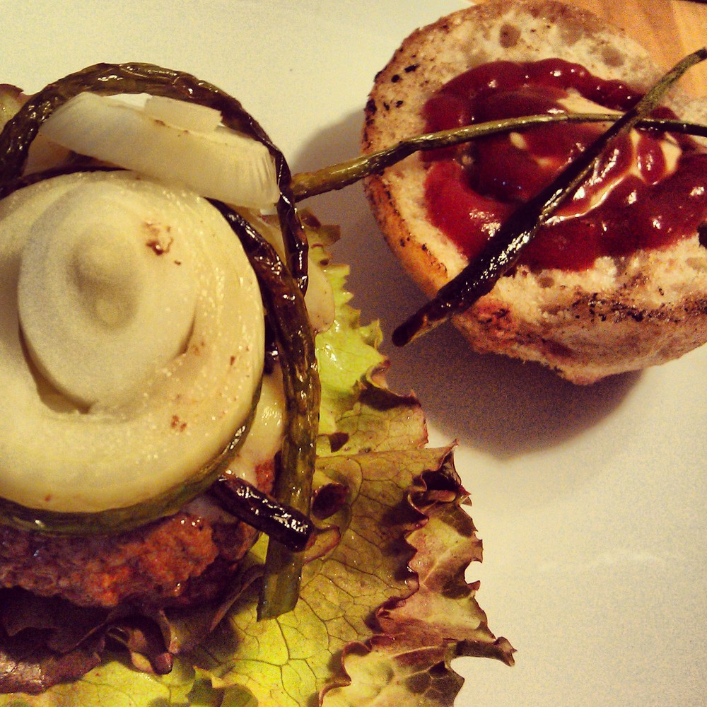 Burger with fermented garlic scopes and tomato chutney.