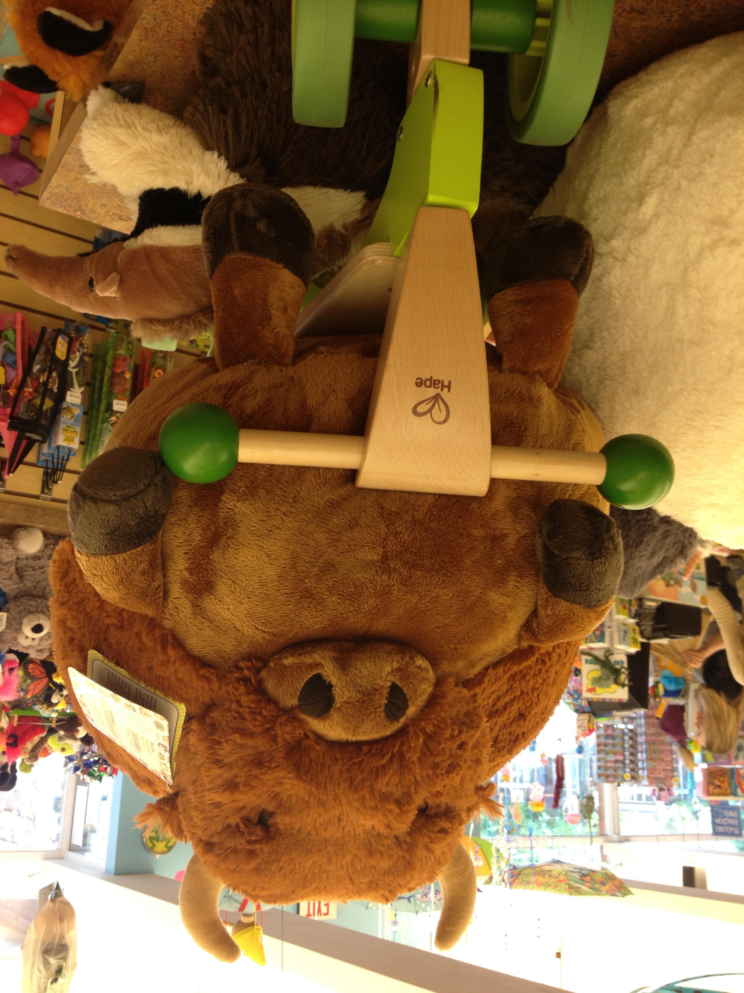 Toys_in_Portland_squishable_buffalo_on_hape_trike