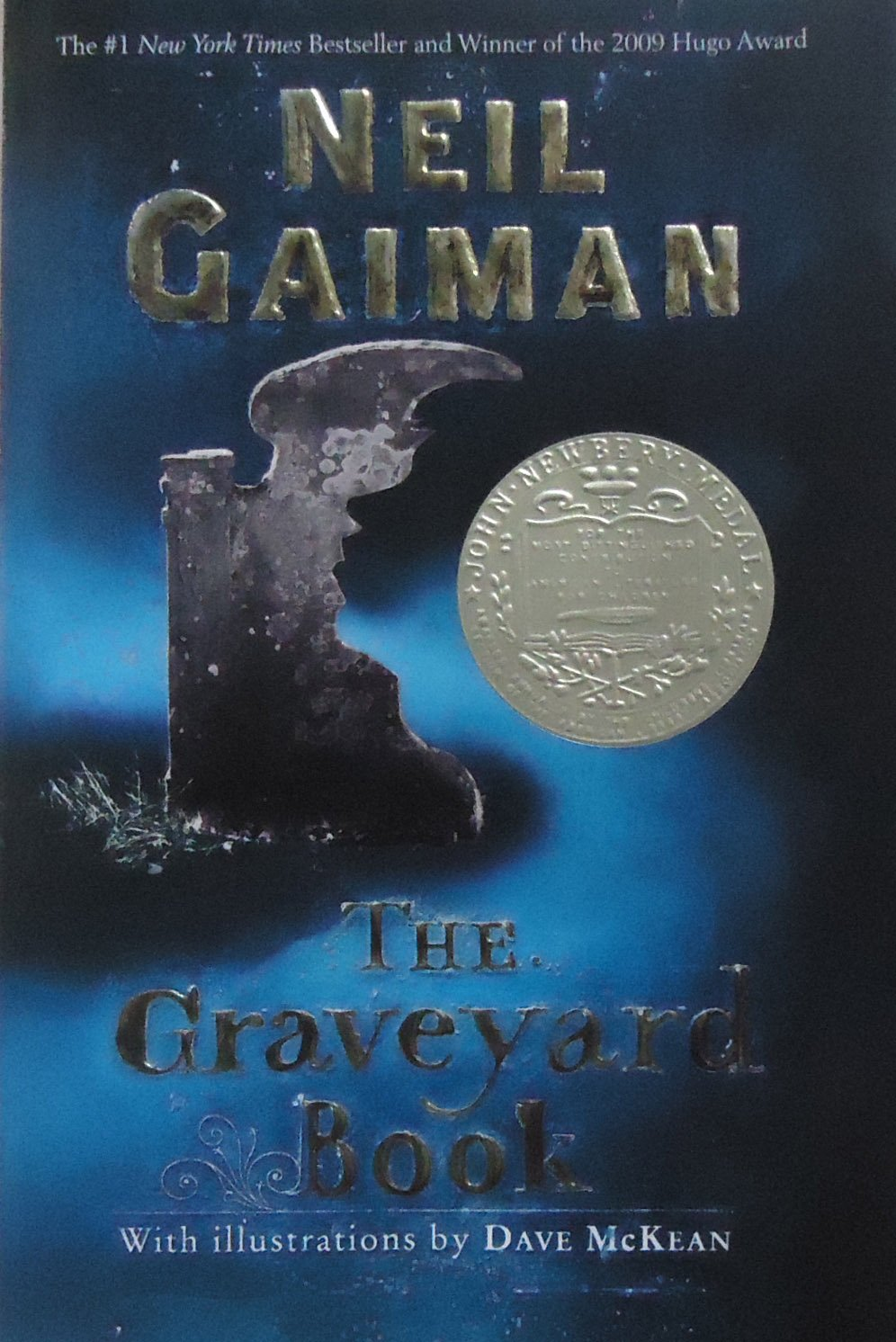 The Graveyard Book  written by Neil Gaiman, illustrations by Dave McKean