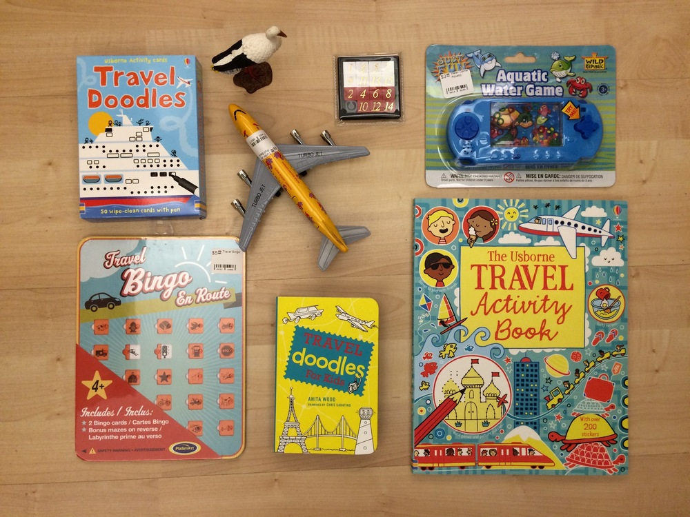 Clockwise from top left: Usborne Travel Doodle Cards $9.99, Die Cast Turbo Jet $9.99, Number Slide Puzzle $1.99, Aquatic Water Game $9.99, Usborne Travel Activity Book $12.99,Usborne Travel doodles for kids $9.99,Travel Bingo card sets $4.99.