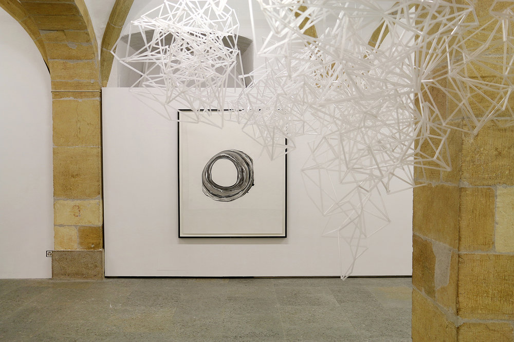 Corona XI, 2012, ink on paper, 151 x 125,5 cm; Liquid Days, 2017, straws, wire, dimensions variable at Centre d'Art Contemporain, Yverdon