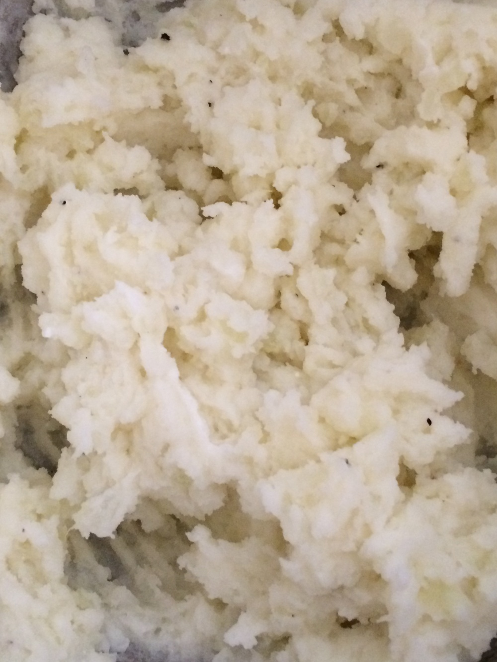 Mashed red potato with goat cheese.