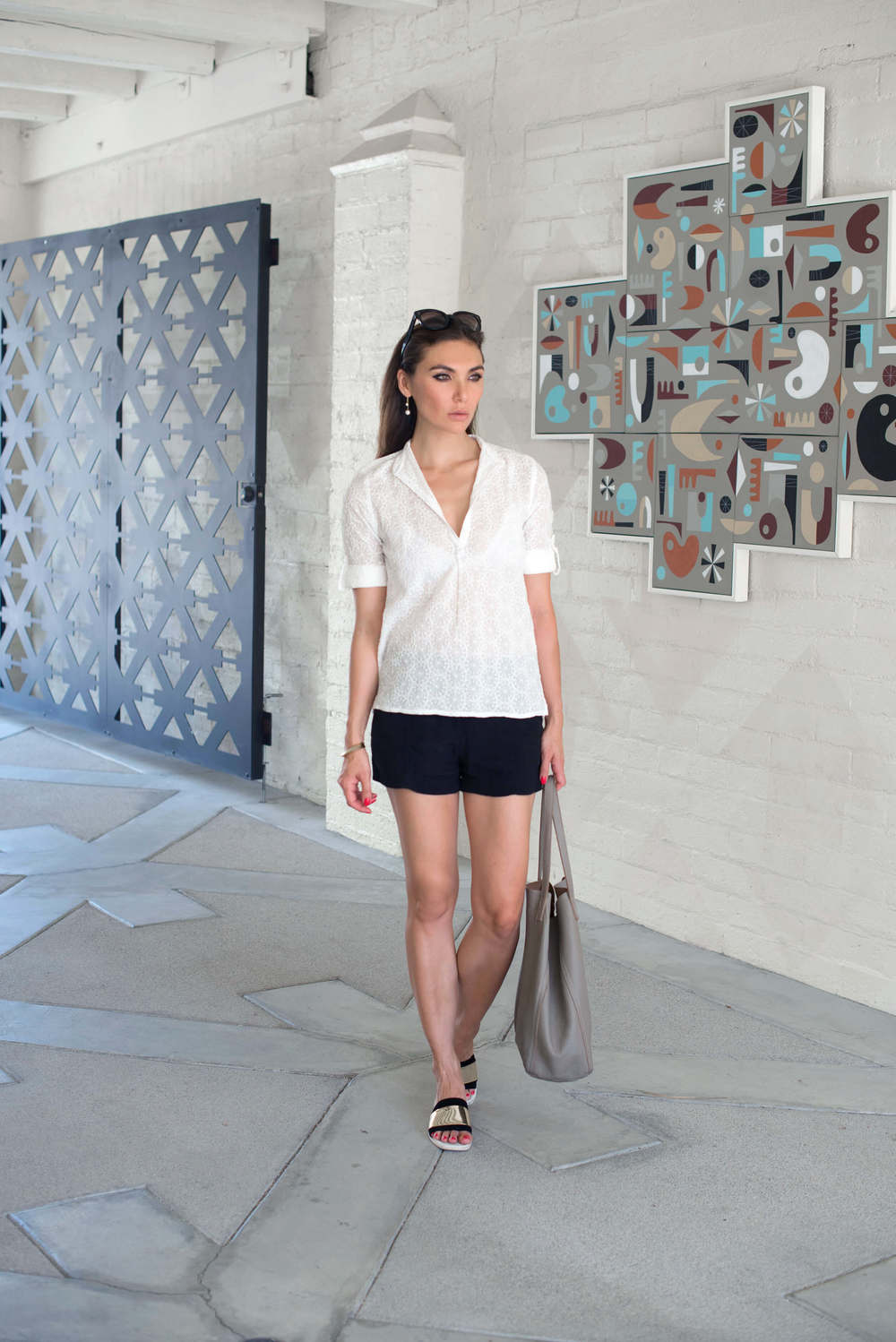 WEARING :   Bell by Alicial Bell Popover Top  ( currently on sale ) ,   Helmut Lang Shorts , Zara Shoes (old,  similar here ),  Cuyana Tote ,  Wanderlust + Co Double Drop Earrings ,  Ona Chan Dagger Bracelet ,  Céline Audrey Sunglasses