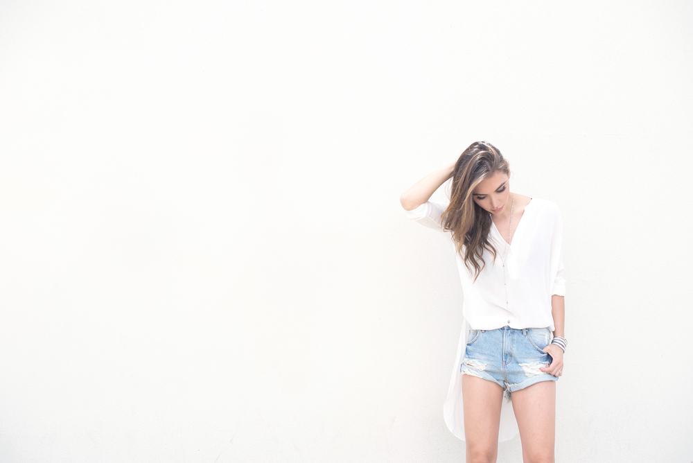 White blouse and denim shorts