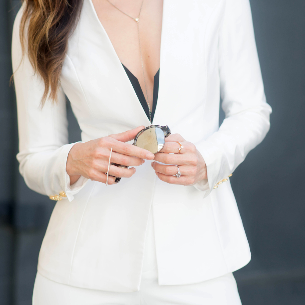 Minimalist black and white outfit and jewelry details