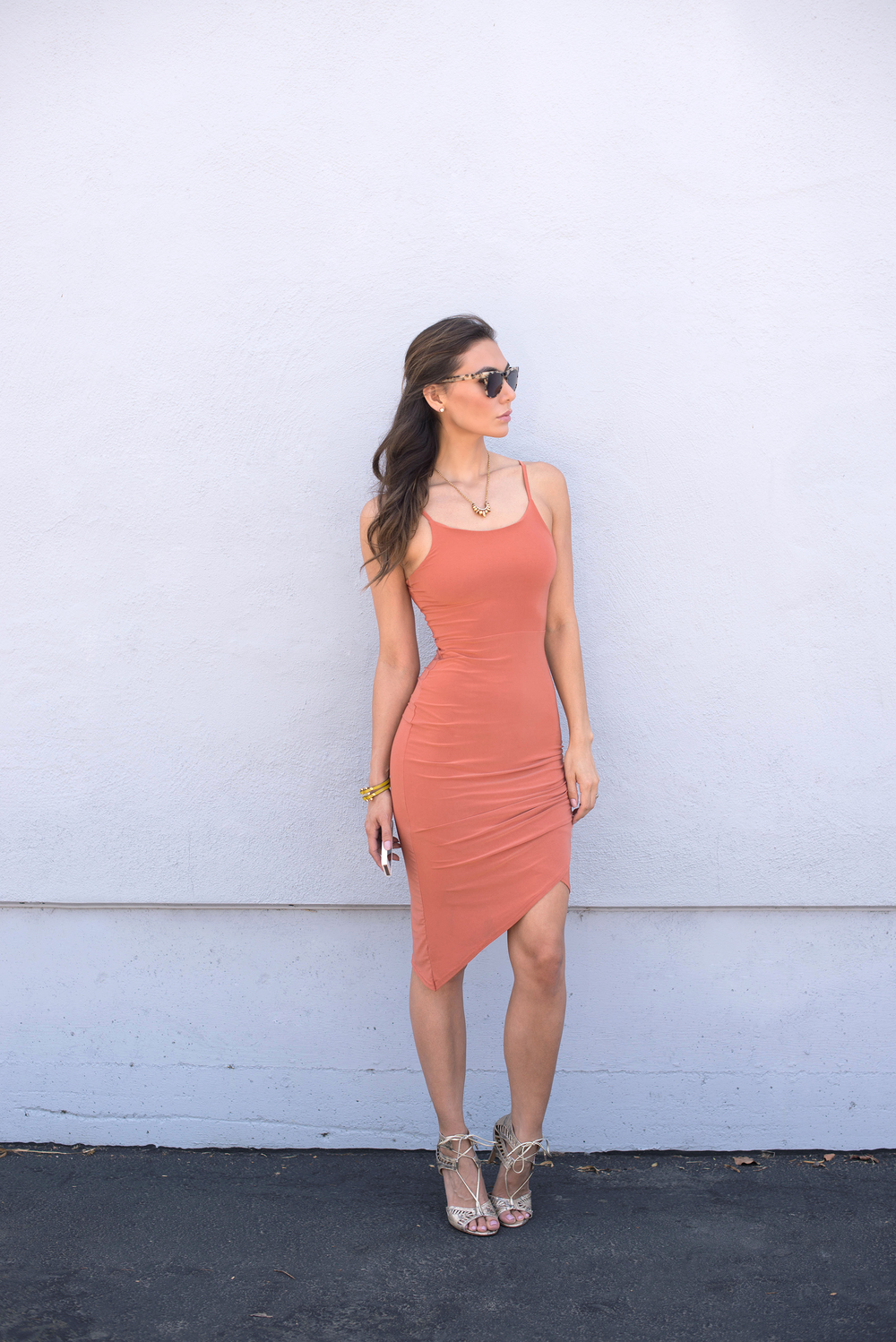 Komono sunglasses, pamela love necklace, and body conscious asymmetric dress