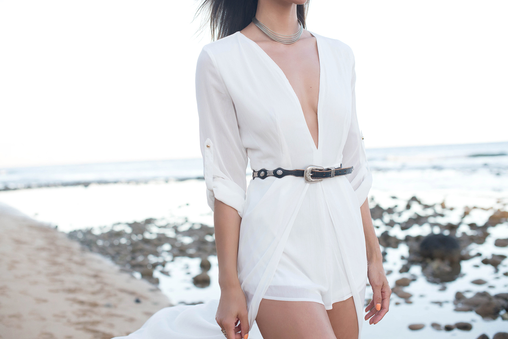 white romper by the beach.