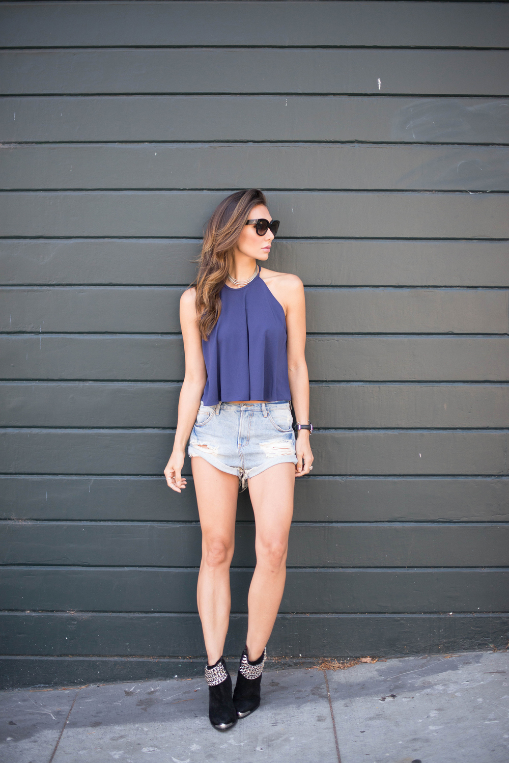 Navy halter top, ankle boots and denim shorts