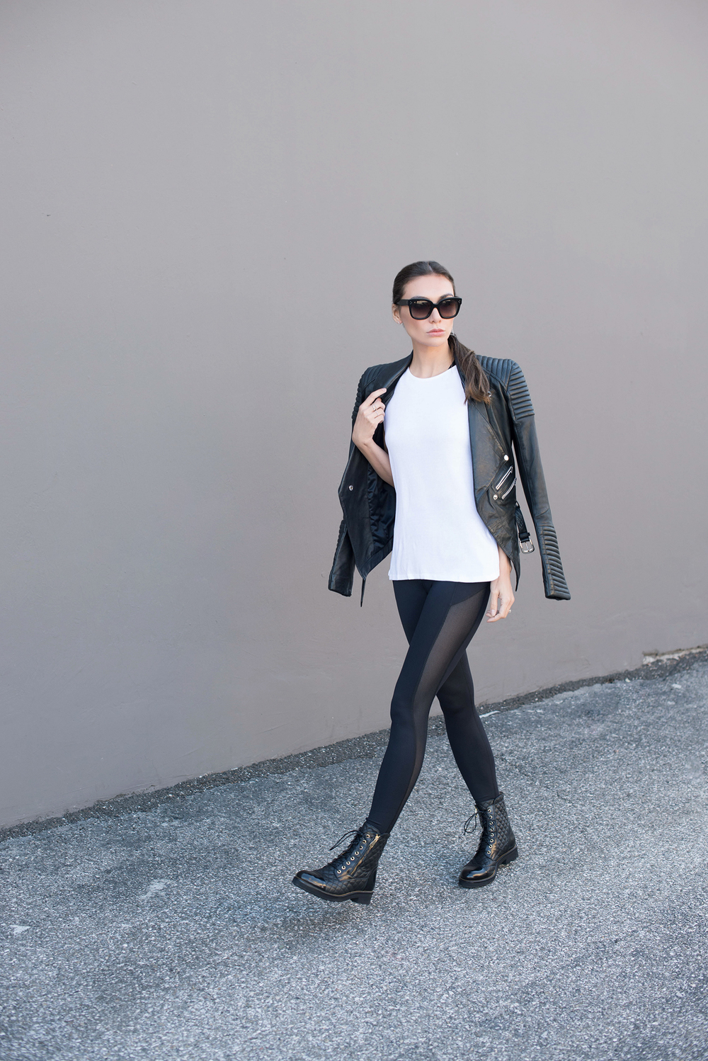 TANK  .   BRA  .   LEGGINGS  .   JACKET  .   SHOES  .   SUNGLASSES  .   HEXAGON RING  .   ORBIT PEARL AND CRYSTAL RING.    EARRINGS.