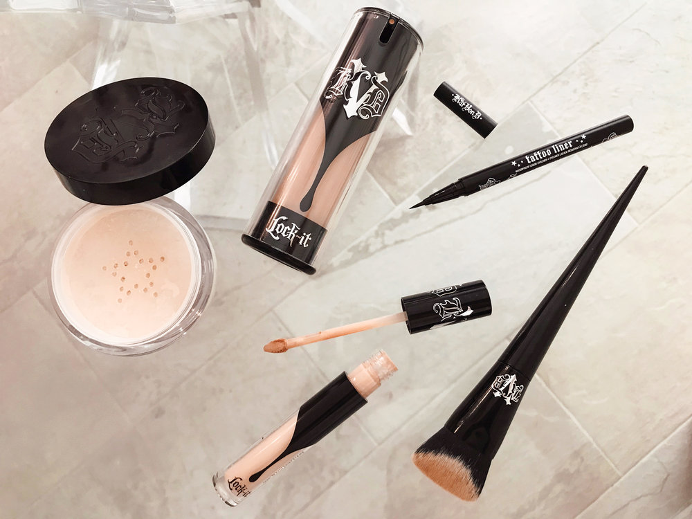 (clockwise from left)  Kat Von D Lock-It Setting Powder ,  Kat Von D Lock-It Foundation ,  Kat Von D Tattoo Liner ,  Kat Von D Edge Foundation Brush ,  Kat Von D Lock-It Concealer Creme