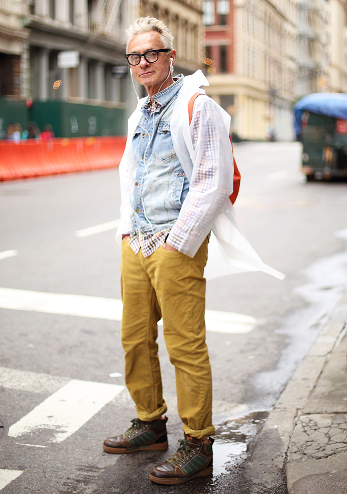 Layer denim over a playful button-up and under a see-through pancho for those rainy days. (Photo of Corey)