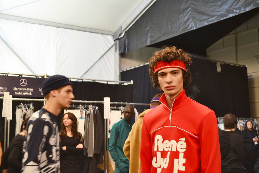 lots and lots of French male models backstage… those curls tho! 70's inspired!