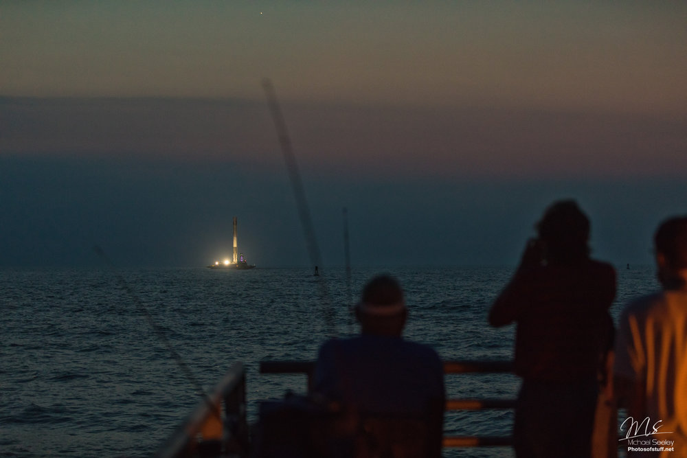 The view of the SpaceX SES10 first stage, returning to port.
