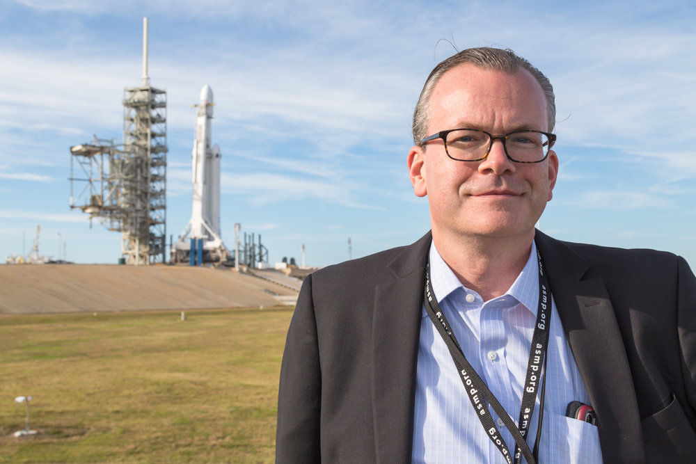 Michael Seeley (me) with the Falcon Heavy behind me. This photo was taken by the great Ben Cooper while we were setting up remote cameras at Launch Complex 39A.