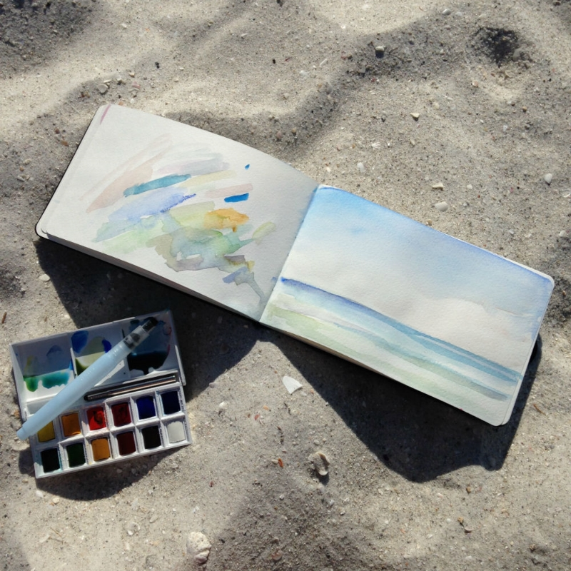 My moleskin journal, a little box of paints and a self moistening brush (LOVE) are all I need for painting on the beach.