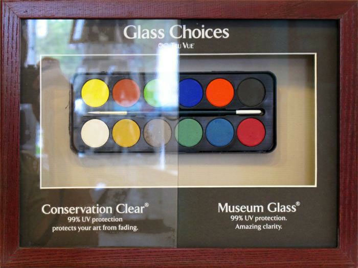 If you can afford it, museum glass is the way to go. It cuts down on glare and you can hardly tell it's there! Image via  C4 Contemporary Art