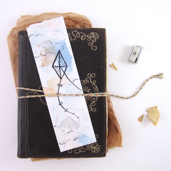 The colors on this bookmark brought to mind a windy day, perfect for kite flying.