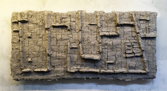 Untitled-4 , 2014, unfired clay, 25 x 52 cm