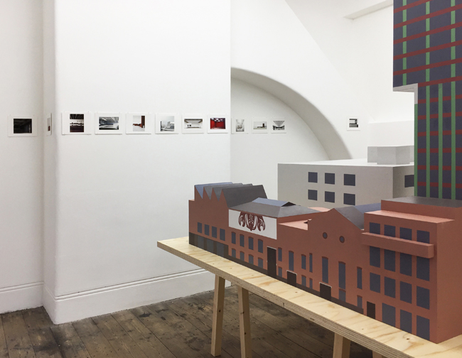 Exhibition view with the model of Newport Street Gallery in the foreground