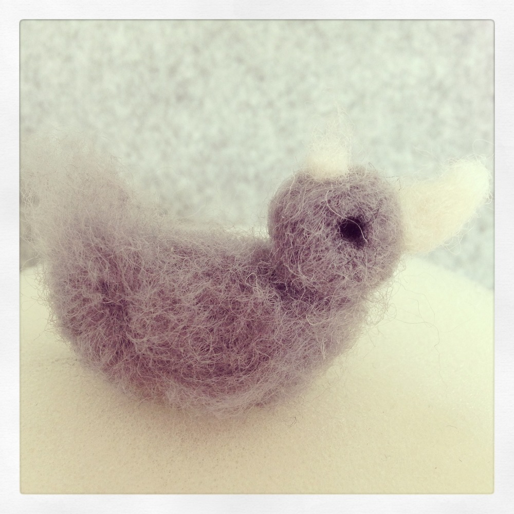 Astrid's first felting attempt. A little fluffy duck :)