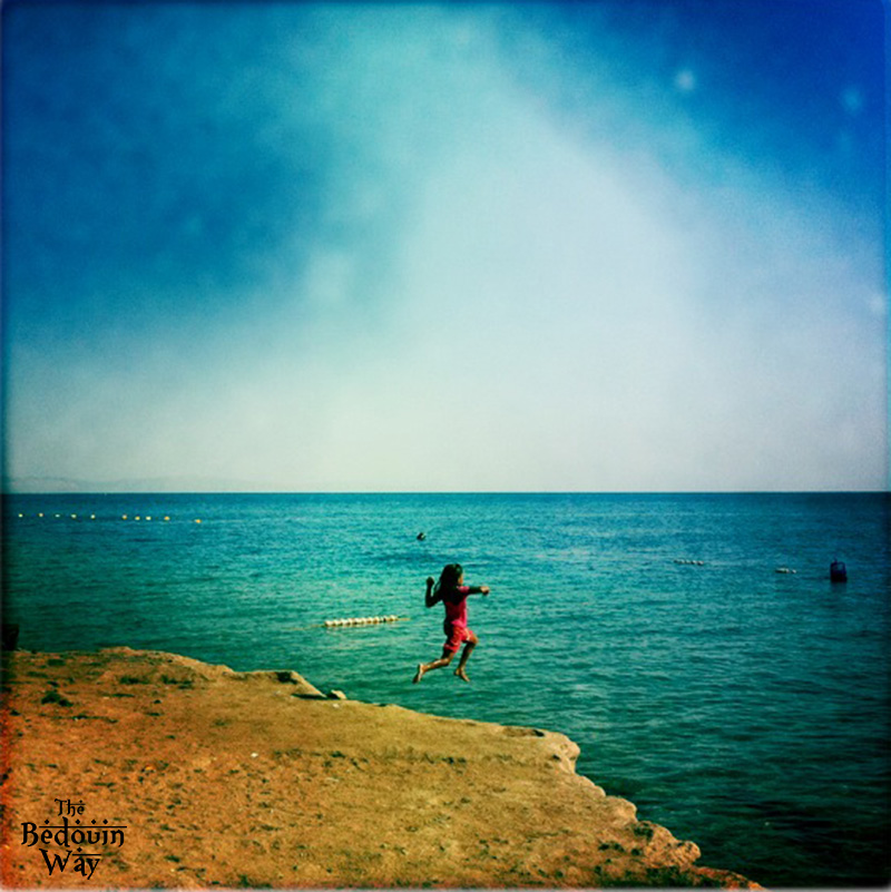 bedouin-girl-jumping-in-sea