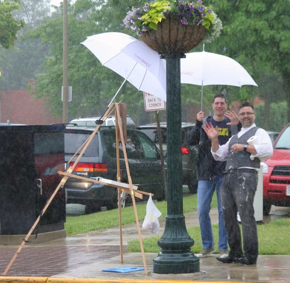 Artists Brian Sindler and Jason Prigge working it out in the rain during Cedarburg Plein Air.  Photo credit: Cedarburg Artists' Guild