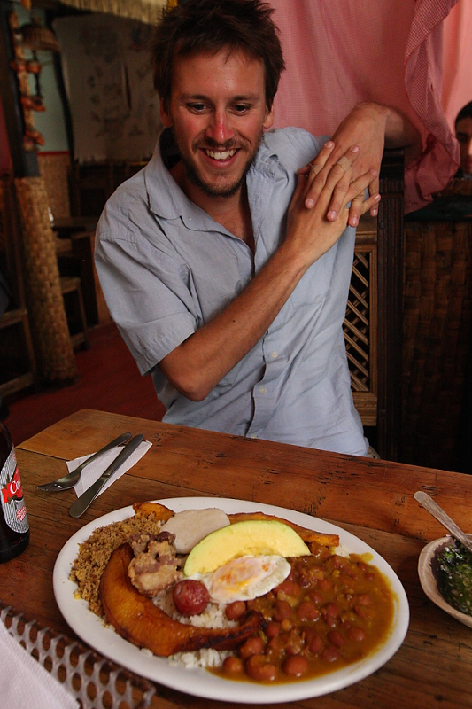 The author eyeing a plate of bandeja paisa, the delicious  Antioquian farmers' breakfast.