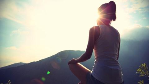 179_1_Treat_10-secrets-for-preserving-self-and-sanity_Slideshow_179_woman-doing-yoga-mountain_ts-479498312.jpg