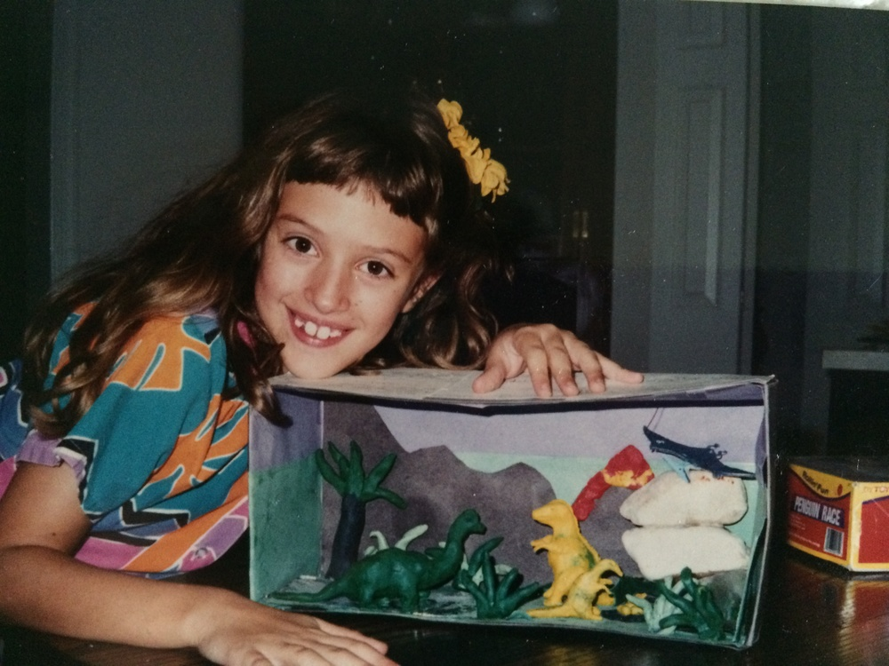 Yes, this is me with a diorama of clay dinosaurs. And bangs.