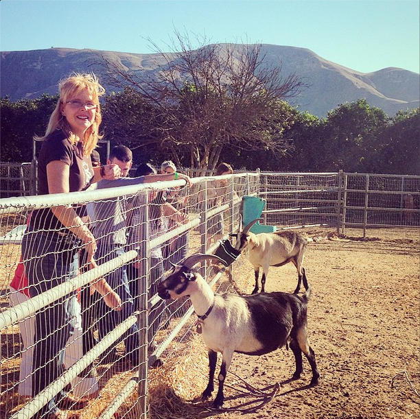 donna-leading-goat-farm-tour.jpg