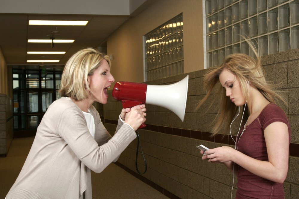 Woman-yelling-through-a-bullhorn-at-an-unfazed-teenage-girl-172808685_1258x839 (1)_Web.jpeg