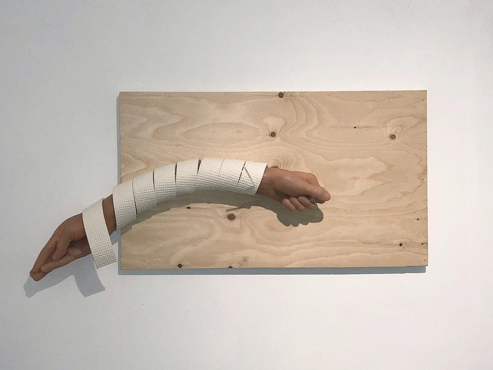 "Copy of Maryam Jafri. Schadenfreude (2017). 32""x 4""x 18"". plywood, silicone, Acupuncture needle (in casing), yoga mat"