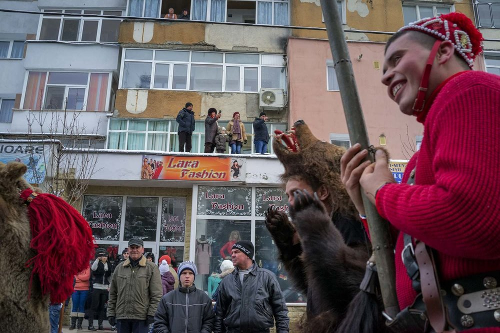 Troupes of bears from nearby towns and villages dance down the main street in Moineşti during the town's annual Bear Parade. December 27, 2014. Moineşti town, Bacău county, Romania.