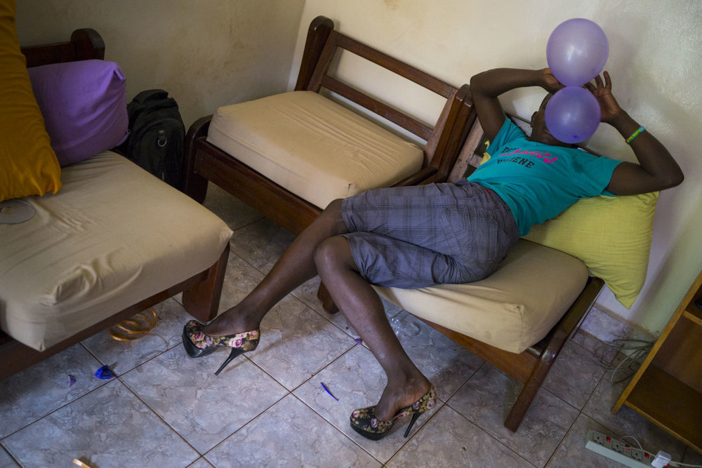 A transgender woman prepares for the festivities that evening. Kampala, Uganda. August 6, 2015.