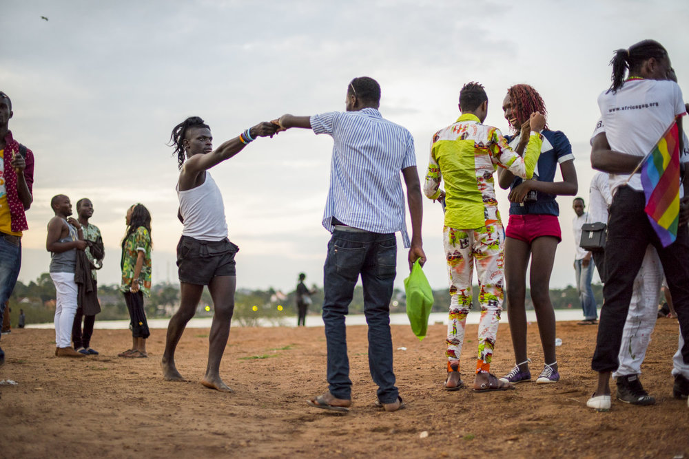 After the Pride march, members of the LGBT community and their supporters celebrate into the evening on the shores of Lake Victoria in Entebbe, 40 km from Kampala. Safety concerns made it impossible to hold the march in a more public location like downtown Kampala. Entebbe, Uganda. August 8, 2015.